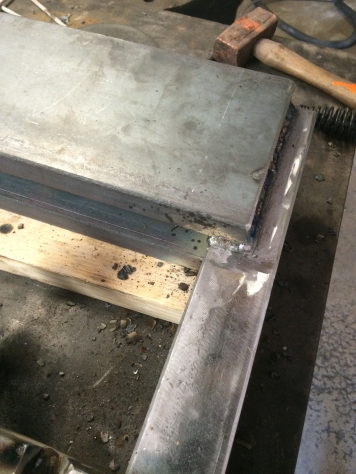 welding top of ram frame